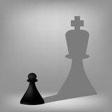 Black Pawn with King Shadow Stock Photos