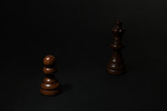 Black Pawn and Queen on black background. Chess. Black Pawn and Queen on black background Stock Photo