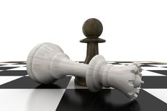Black pawn standing over fallen white queen Royalty Free Stock Image