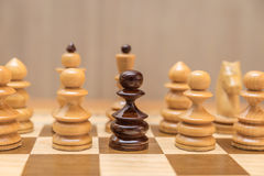 Black pawn is among white pawns Royalty Free Stock Images