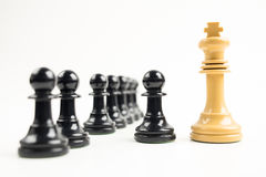 Black pawns in front of white king Stock Photo