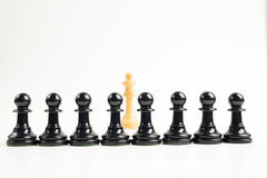 Black Pawns in front of white king Royalty Free Stock Photos