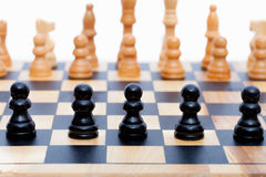 Black pawns lined up Royalty Free Stock Photos