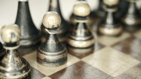 Black pawns row. Vintage wooden chess with focus on pawns, sliding camera movement stock video