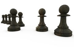 Black pawns in a row Royalty Free Stock Image