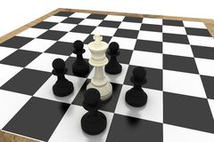 Black pawns surrounding white king Stock Images