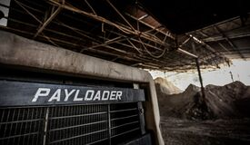 Black Payloader in Hanger Royalty Free Stock Photography