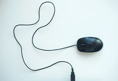 Black pc mouse with long cable Royalty Free Stock Image
