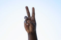 Black peace sign. A black man makes a peace sign Stock Photography