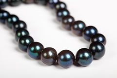 Black pearl necklace. Close up of black pearl necklace stock photo