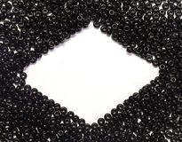 Black pearls. Scattered on a white background with place for text Royalty Free Stock Photos