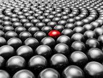 Black pearls. Different from other. Not like the other. Red pearl surrounded by black pearls Stock Photos