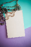 Black pearls accessorie on lilac background Stock Photo