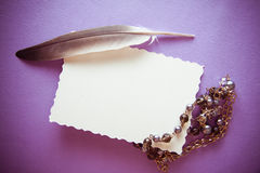 Black pearls accessorie on lilac background Royalty Free Stock Photo