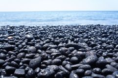Black pebble beach on the Big Island of Hawaii. Near Kona royalty free stock images