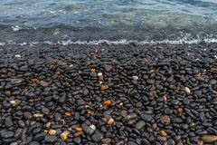 Black Pebble Beach in Chios island Greece stock images