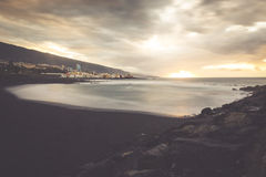 Black pebble beach in Puerto de la Cruz by the sunset , Tenerife Royalty Free Stock Photos