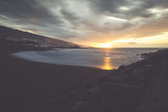 Black pebble beach in Puerto de la Cruz by the sunset , Tenerife Royalty Free Stock Image