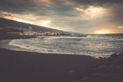 Black pebble beach in Puerto de la Cruz by the sunset , Tenerife Stock Images