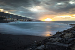 Black pebble beach in Puerto de la Cruz by the sunset , Tenerife Royalty Free Stock Images