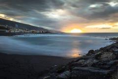 Black pebble beach in Puerto de la Cruz by the sunset , Tenerife Royalty Free Stock Images