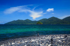 Black pebble island near Lipe island, Thailand Stock Photo