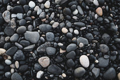 Black pebble stones. On the ground at black sand beach in Iceland Royalty Free Stock Photos