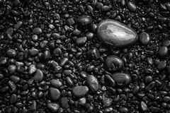 Black pebbles background pattern Stock Images