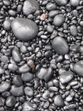 Black pebbles on the road to Hana, Maui Royalty Free Stock Image