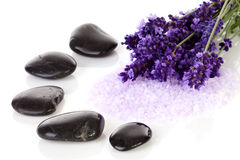 Black pebbles stones and lavender flowers. Over white background Stock Photo