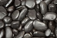 Black Pebbles Texture Stock Images