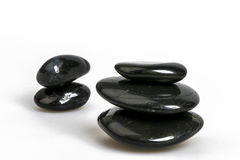 Black Pebbles. On white background Royalty Free Stock Images