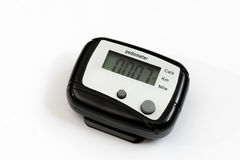 Black pedometer over white background Stock Photos