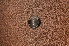 Black peephole in  brown iron door Stock Photos