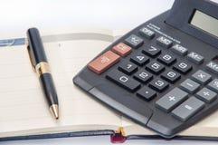 Black pen and calendar with calculator Royalty Free Stock Photos