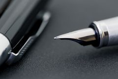 The black pen with a cap on a black background, business concept Stock Photography