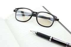 A black pen and empty open book. On white background Royalty Free Stock Images