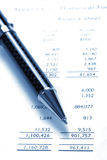 Black Pen On Financial Balance Sheet. Business / Finance, Background, Blue Tone royalty free stock photo