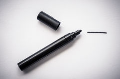 Black pen and a hand drawn line, isolated on white background. Stock Image