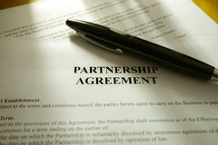 Black Pen lies on a partnership contract Stock Photos