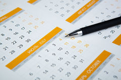 Black pen lying on the calendar Royalty Free Stock Image
