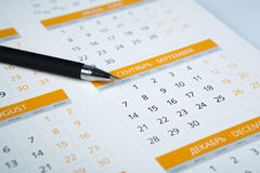 Black pen lying on the calendar Royalty Free Stock Photo