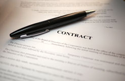 Black Pen lying on a contract Stock Images