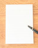 Black pen on note paper Royalty Free Stock Image
