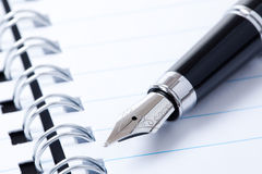 Black pen and notebook Royalty Free Stock Photography