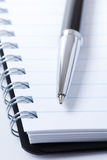 Black pen and notebook Royalty Free Stock Images