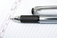 Black pen with notebook Royalty Free Stock Images