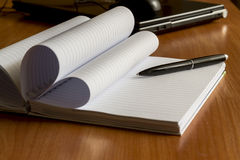 Black pen and notebook, closeup Stock Photography