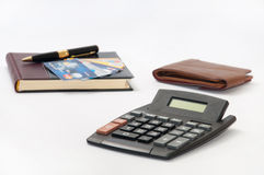Black pen and notebook with credit cards, wallet and calculator Royalty Free Stock Photo