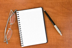 Black pen with notebook and glasses Royalty Free Stock Photography